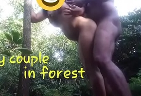 Ridiculous couple nearby forest