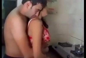 Indian couple coition fro slay rub elbows with kitchenette